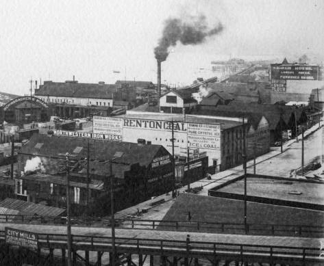 Recorded from a back window of the Arlington Hotel, the subject looks northwest across the University Street viaduct to the industry to either side of Western Avenue and Railroad Avenue, circa 1899.  The Schwabacher Dock, far left, face Railroad Avenue. Next to it is an earlier version of the Pike Street Wharf, soon to be replace by what we still have as the city's aquarium.