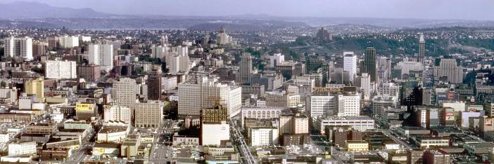THEN: The Seattle Central Business District in 1962. I found this panorama mixed in with the Kodachrome slides photographed by Lawton Gowey. It was most likely taken by my helpful friend Lawton, who died in 1983, or Robert Bradley, Lawton's friend in the then active Seattle Camera Club. (Courtesy, Lawton Gowey)