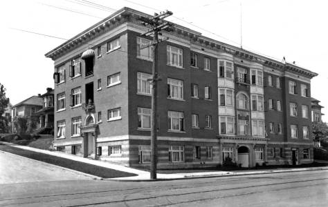 THEN: We have by three years or four missed the centenary for this distinguished brick pile, the Littlefield Apartments on Capitol Hill.  (Courtesy Lawton Gowey)