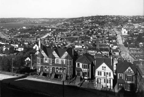 Wallngford is far off on the north side of Lake Union, here on the far left horizon.  Stewart street is on the right, and Fourth Avenue at the base of this A. Curtis photograph from ca. 1904.  Capitol Hill covers most of the horizon.