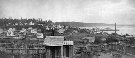 The oldest pan of Seattle among the many taken from Denny Hill.  The date is 1871/2.  The summit of First  Hill, far left, is still forested.  The King Street Coal Wharf is still five or six years from construction.  Pike Street crosses beyond the fence.