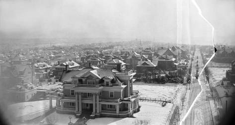 "Damaged snow shot of Capitol Hill from the Volunteer Park standpipe.  The Parker home at the southeast corner of E. Prospect Street and 14th Ave. E. fills the foreground.  With its early 20th Century creation by super-developer James Moore, 14th Ave. here south of the park was also known as ""Millionaire Row."""