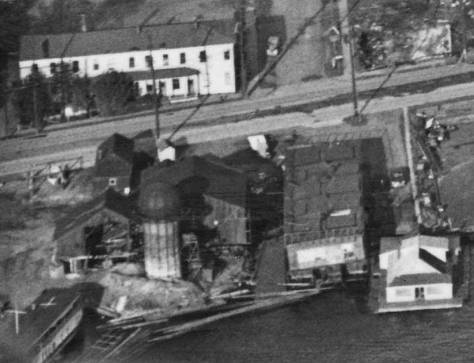 A detail pulled from the late 1950s aerial printed above shows close-up the Wayland Mill, future Salmon House, and the Northlake Apartments at the northwest corner of Northlake and 5th Ave. N.E..