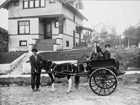 Frank DeBruyn with wagon in front of the family home at 4123 Eastern Ave. N..
