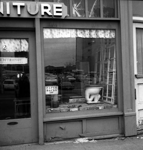Plumbing fixture and Ten Cent paperbacks near the market - more Frank Shaw in 1975