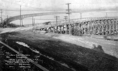 Looking northeast from Avalon to the point where the early - in 1913 - Spokane Street trestle reaches West Seattle.  Courtesy, Seattle Municipal Archive