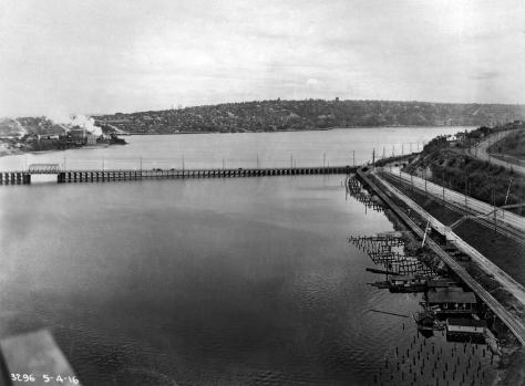 Here the daring photographer has turned around, again on May 4, 1916, to look west over the Stone Way Bridge and the smoking Gas Works to a Capitol Hill horizon.  Note the generations of Westlake (25 years worth) both hugging the shore and taking it on the right.  Dexter descends to the bridge, far right.