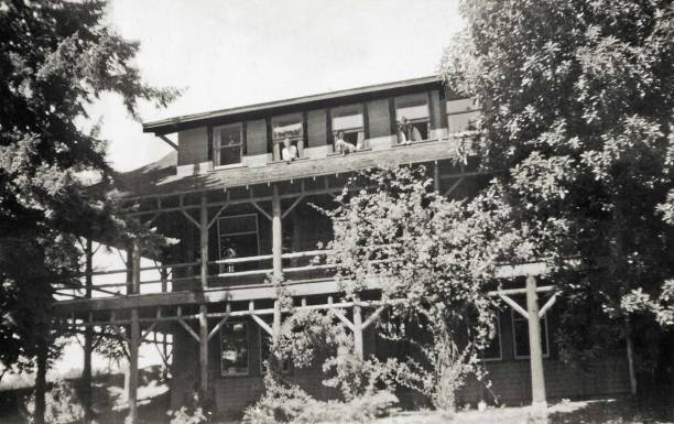 THEN: The Gatewood Craftsman Lodge was built on a road, in a neighborhood, and near a public school all named for the developer Carlisle Gatewood, who also lived in the neighborhood. The three women posing in the third floor's open windows are the Clark sisters, Jean, Dorothy and Peggy, members of the family that moved into the home in the late 1930s.