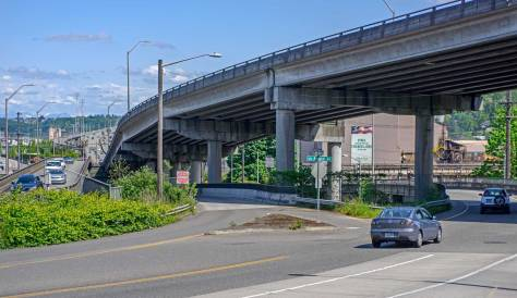 NOW: The undulations and elevations required to lift Spokane Street high above the waterways and railways are evident in the Jeanette Williams Memorial Bridge (aka West Seattle High Bridge), seen just left of its west end extension with the ascending Fauntleroy Expressway on the right.