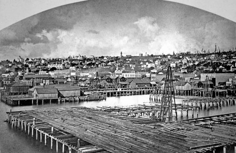 During his 1882 visit to Seattle, Watkins also used the King Street Coal Wharf to record a panorama of what was by then the largest city in Washington Territory.  In this one of the panels from his pan, the location of lynching is