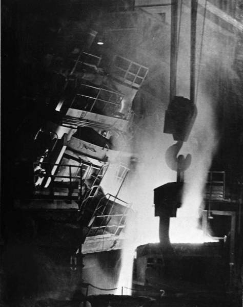"The MOHAI caption for this print expresses itself. ""Always a dramatic sight . . . steel poured from an electric furnace at Bethlehem's Seattle Plant.""  [Courtesy, MOHAI]"