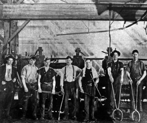 An early crew at Seattle Steel takes a break from its heavy labor at the rolling mill.  [Courtesy, MOHAI]