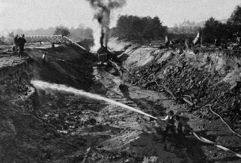 "The first Army Corp decreed digging of the canal between Fremont and Ballard, and early, 1903.  The creek was ""regularized"" but the funding insufficient to do much more.  This scene like the one above it (we think) looks west.  (Courtesy, Army Corps of Engineers)"