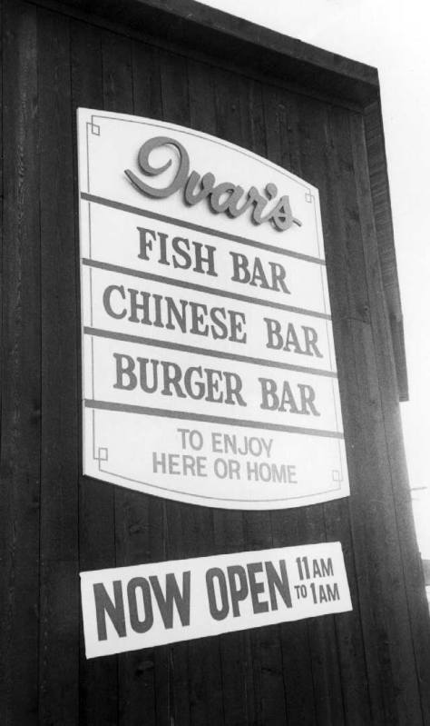 The sign to Ivar's Fish Bar on Denny Way. The variety of menus was something he introduced with his fire drive-in in a converted Capitol Hill gas station on Broadway Avenue at Thomas Street in the 1950s.