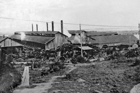 "THEN: The Seattle Times in its lengthy coverage of the then new Seattle Steel in the paper's Magazine Section for Sept. 10, 1905 – the year this photograph was recorded – noted that ""the plant itself is a series of strong, substantial, cavernous sheds, built for use, not for beauty.""  (Courtesy, MOHAI, the Museum of History and Industry)"