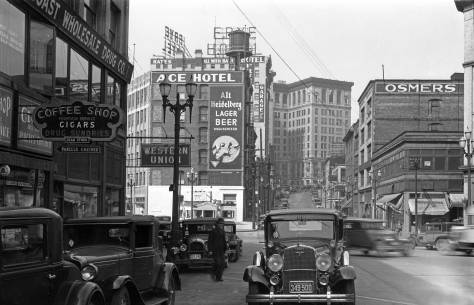 THEN: 1934 was one of the worst years of the Great Depression. This look north on Third Avenue South through Main Street and the Second Avenue South Extension was recorded on Thursday, April 19th of that year. Business was generally dire, but especially here in this neighborhood south of Yesler Way where there were many storefront vacancies. (Courtesy Ron Edge)