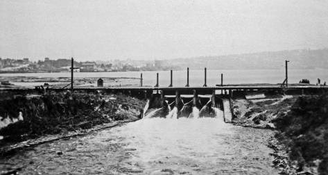 Looking east from the Fremont low bridge (one of them) to the dam at Fremont - the one that gave way in 1914. (Use the keyword search box to find the recent feature about that wipe out.)  This view dates from 1906 or 1907, and appears in the same Seattle Gas album (courtesy of Mike Maslan) as the featured photo at the top and a few more below.