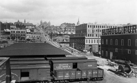 The Northern Pacific photographer F.J.Haynes look east up Madison Street from the coal trestle that passed over Railroad Avenue to the coal pier at the foot of Madison.   (Courtesy, Tacoma Public Library)