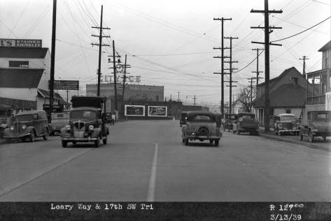 This snap in the billboard survey looks thru the same Leary curve but from the southeast end of it.  So it looks northwest on Leary.  The date, March 13, 1939 is recorded, bottom-left.  [A personal reflection to share: born in the fall of 1938, it was then barely babbling when this shots was recorded, and here and now nearly 76 years later, I blabber on and on.