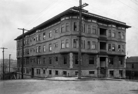 THEN: Faced, in part, with brick veneer and stucco, and opened in 191l, the Comet Apartments at 170 11th Avenue have made it nicely through their first century.  (Courtesy, Lawton Gowey)