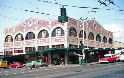 As he was often inclined to do, Lawton returned to record the Corner Market Building after its restoration, here on April 21, 1976, about half-a-life ago for some.