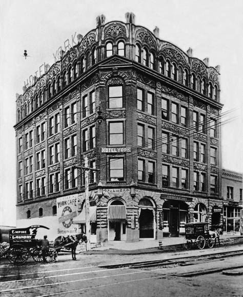 THEN: The Hotel York at the northwest corner of Pike Street and First Avenue supplied beds on the American Plan for travelers and rooms for traveling hucksters. (Courtesy Lawton Gowey)