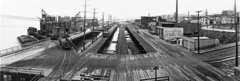 Merged from two negatives, Railroad Avenue looking north over Wall Street.