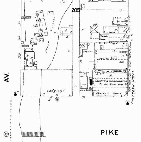 The footprint of the abandoned Hotel York appears lower-right in this detail from the 1904-5 Sanborn Real Estate Map.  The stairs to the waterfront show bottom-right and upper right a few footprints of the sheds and shacks that held to the bluff.