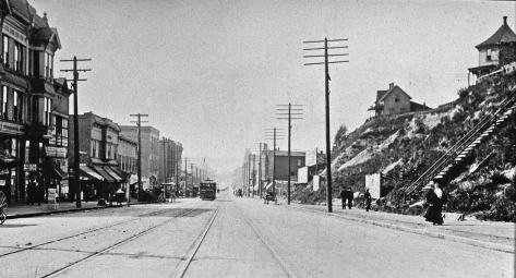 The temporary bluff along the east side of First Avenue, ca. 1902.  The view looks north from near Virginia Street.