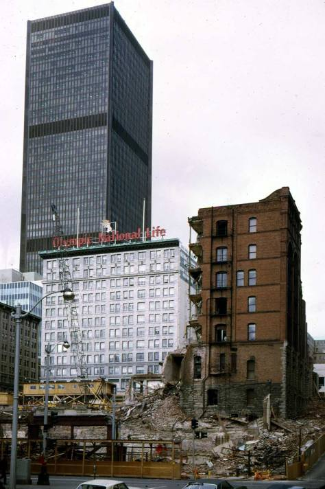 Like the Wesbster and Stevens studio subject above it, Lawton Gowey's record looks thru the intersection of First and Marion and the ruins of both the Stevens Hotel and the Burke Building.  Less than ten years old, the SeaFirst tower