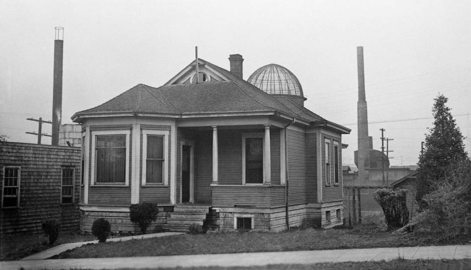 THEN: First designated Columbus Street in the 1890 platting of the Brooklyn Addition, and next as 14th Avenue to conform with the Seattle grid, 'The Ave,' still its most popular moniker, was renamed University Way by contest in 1919. This trim bungalow at 3711 University Way sat a few lots north of Lake Union's Portage Bay. (Courtesy, Washington State Archives, Puget Sound Regional Archive)
