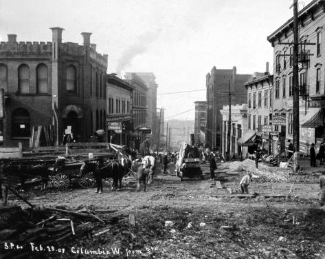 Columbia Street, looking west thru Third Avenue during the latter's 1907 regrade.  The post office has moved on to First and University, and will soon be moving further into its headquarters at Third and Union.  The next photo is earlier and shows the P.O..
