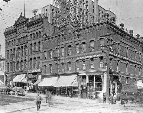The Wa-Chong Building in the old Chinatown at the northeast corner of Second Avenue and Washington Street, before the Second Ave. Extension.  Part of the building survives.  Here the Frye Hotel towers above and behind it.
