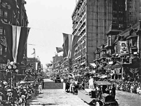 "The Golden Potlatch Parade of 1913, the ""Dad's Day"" floats are in the foreground."