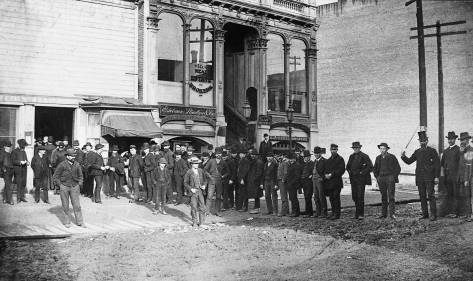 The mid-1880s Mail line leading into the pioneer P.O. on Mill Street (Yesler Way) between Post and Western.