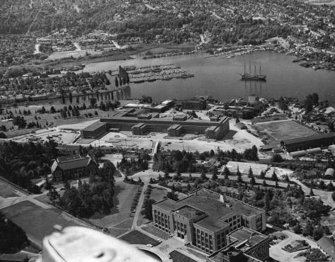 An aerial with a splendid witness to Anderson Hall on the left and the new UW Medical School above it.  Can you name the ship resting on Portage Bay?  Watch for clues on local billboards.
