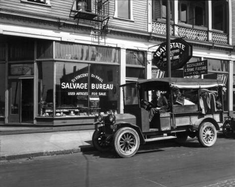 "THEN: St. Vincent de Paul's first storefront opened in 1926 in Belltown's grand clapboard hostelry at the corner of First and Battery. Originally the Bellevue Hotel, it's reduced here to the ""house keeping and transient rooms"" of the Bay State Hotel. (MOHAI)"