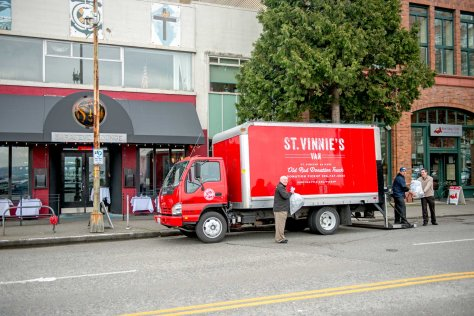 NOW: One of the four St. Vinnie's red trucks now running picks up some donations from the proprietors of the Sarajevo Lounge, a trendy Belltown Balkan dining establishment at the corner once home to St. Vincent de Paul's first storefront thrift store.