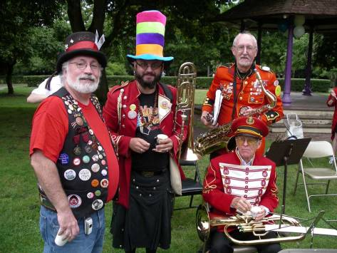 FRESH AND LOOSE from Ballard, three members of the Ballard Sedentary Marching Band before - or perhaps after - a concert at the Good Shepherd's Bandstand in Wallingford.   The well decorated veteran on the left may not be a member of the band.  I remember him better from the pubs of Pioneer Square.  This dates from about 2007 and was taken during my daily Wallingford Walks then.