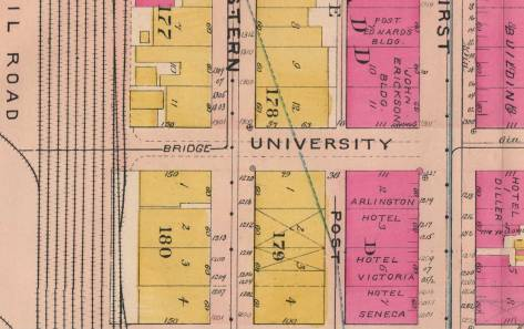 A detail from the 1908 Baist Real Estate Map, showing the two blocks on University Street where the viaduct for wagons built after the Great Fire of 1889 reaches Railroad Avenue from First Avenue.