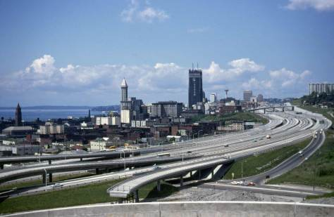 Lawton Gowey's 1968 pan of the city from Beacon Hill.  The SeaFirst building is approaching its topping-off.   It is barely a year since the full-freeway's dedication.  Correction.  Not quite full.  Note the ramp to nowhere at the bottom.  It would remain so for comedic years to come.
