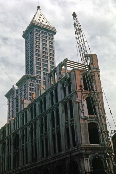 THEN: In Lawton Gowey's 1961 pairing, the Smith Tower (1914) was the tallest building in Seattle, and the Pioneer Square landmark Seattle Hotel (1890) had lost most of its top floor. (by Lawton Gowey)