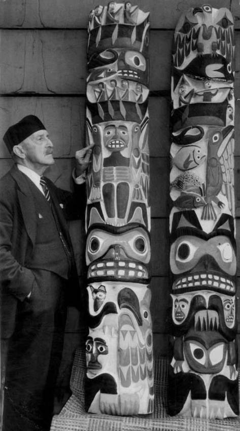 "Daddy Standley standing with two of his totems and never once thinking ""icons."""