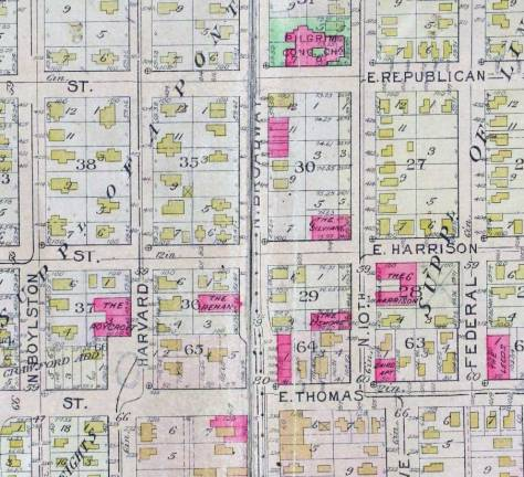 A detail from the 1912 Baist Real Estate Map including here the red footprint for the brick Silvian Apartments.