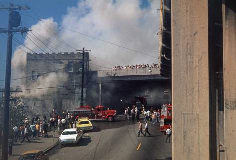 THEN: The 1974 fire at the Municipal Market Building on the west side of Western Avenue did not hasten the demise of the by then half-century old addition of the Pike Place Market. It had already been scheduled for demolition. (Courtesy, Seattle Municipal Archive)