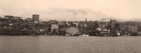"Left of center - or right of the left border - the Hotel York shows why it was advertized as a ""scenic hotel.""  This pan - courtesy of Ron Edge, again - was taken in the late 1890s so all of what shows in the way of waterfront docks are short-lived contributions from the 1890s.  This includes the Ainsworth Pier at the foot of Pike Street.  It was replace ca. 1900 with the pier we have now, the one that anchors the Waterfront Park and is home to the aquarium."