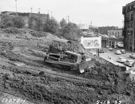 Two years later, grading the former lot of the Lady of Good Help. The Yesler Way overpass is on the right. (Courtesy, Seattle Municipal Archive)