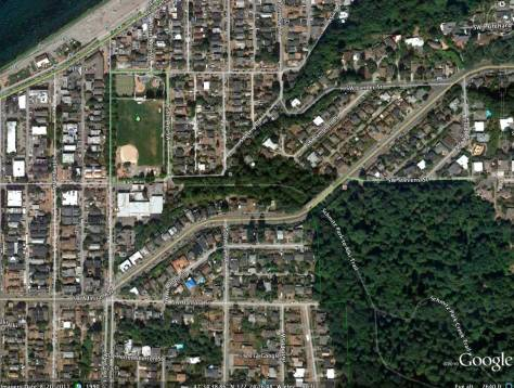 "The Admiral Way bridge is easily found right-of-center in this recent Google-Earth detail. The green Alki Playfield is upper right. It is ""topped"" by the lighter green of the tennis courts at the corner southwest corner of 59th Ave. SW and . Alki Primary School is directly below the play field. Schmitz Park, of course, is lower-right."