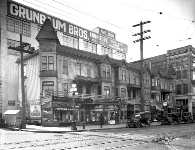 THEN: The row house at the southwest corner of 6th Avenue and Pine Street in its last months, ca. 1922-23. (Museum of History and Industry)