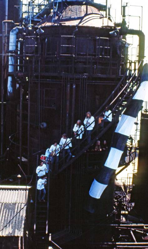 """The band Butterfat trusting the 65-year old construction of the gas works. They are """"accompanied"""" to the right by the """"Universal Worm."""" We also hung one of these from the lip of the Space Needle for eventual use (we hope) in the film/video """"Sky River Rock Fire."""" I, or part of it, may sound familiar to some readers: the survivors."""